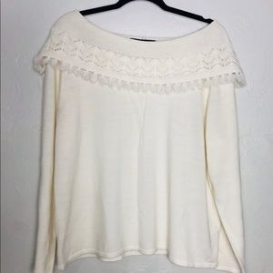 scoop neck cream color sweater with small tassels